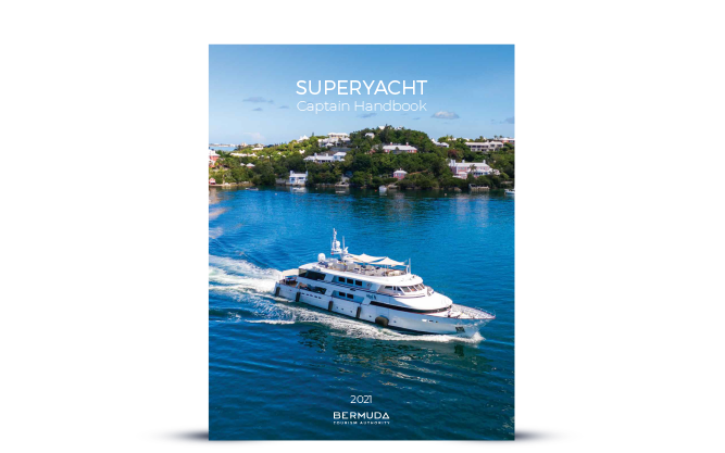 cover image of Superyacht in Bermuda water with houses in background