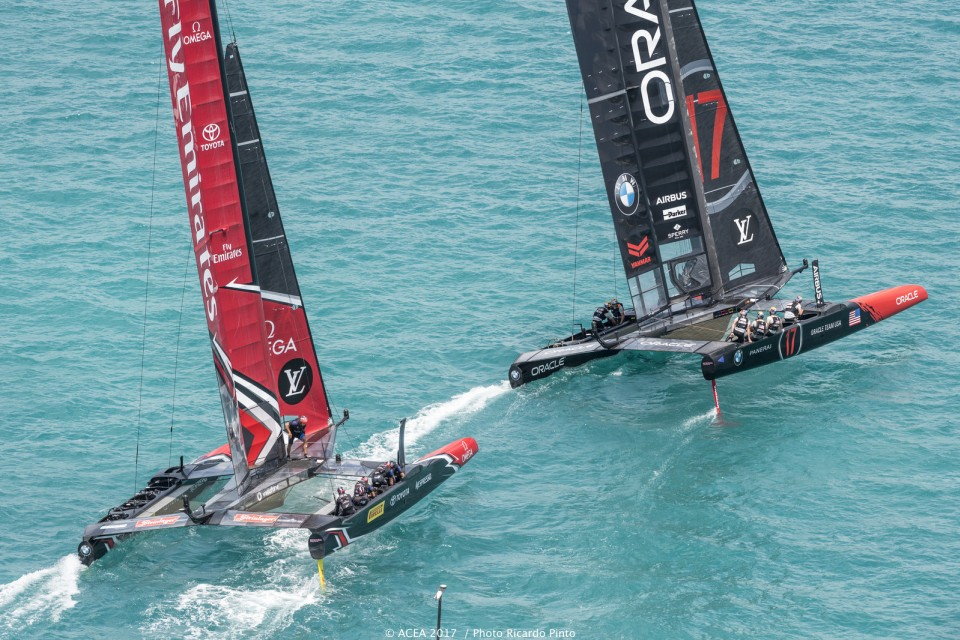 Emirates Team New Zealand trails closely behind Oracle in a moment captured during Day 1 of the America's Cup Match