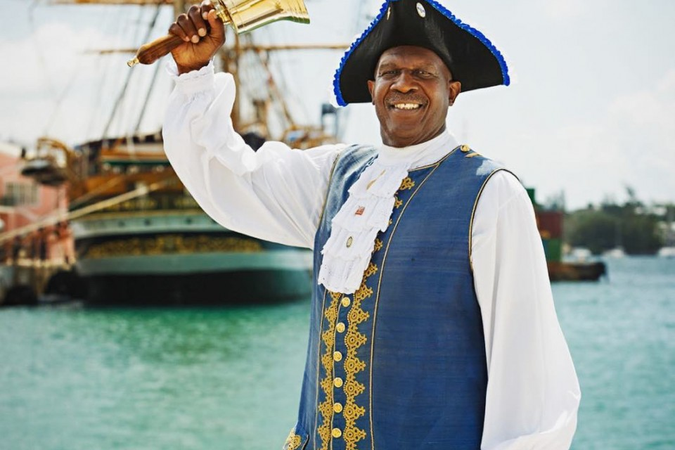 Town Crier with tall ship in background