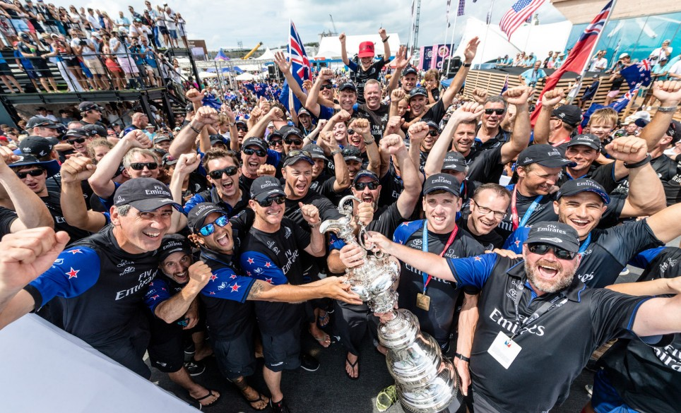 Peter Burling, members of Emirates Team New Zealand and fans celebrate New Zealand's win in Bermuda.
