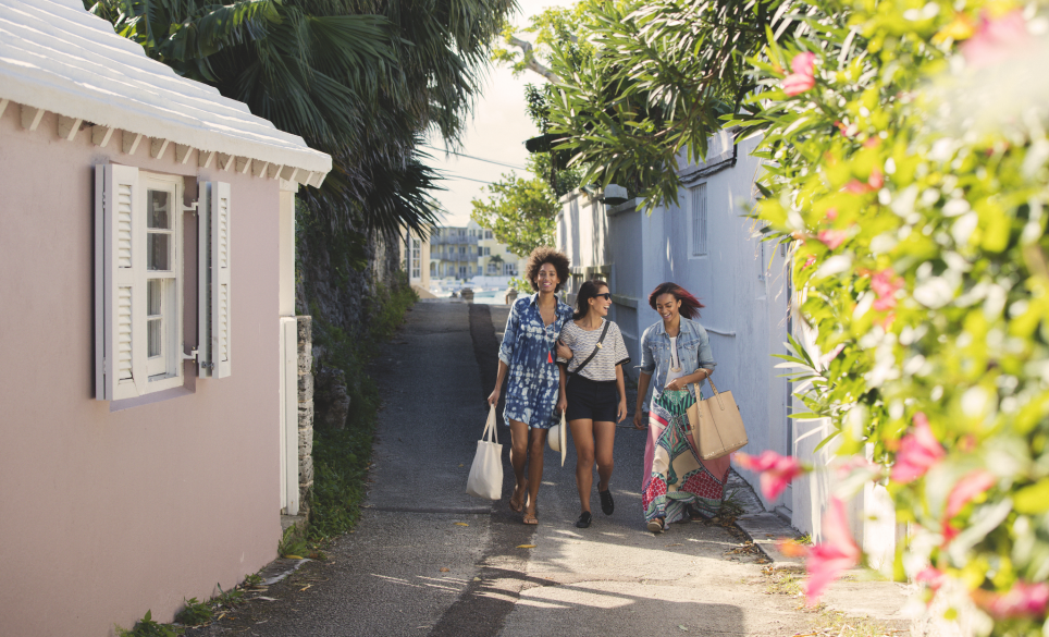 three long time friends walk the streets of bermuda together during their annual girls weekend get together