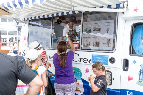 Fans break for ice cream in the America's Cup Village