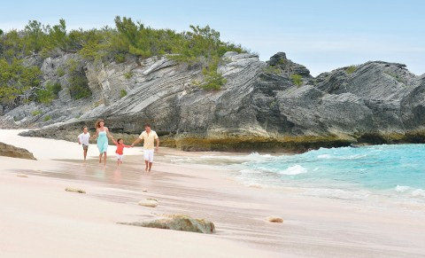 Walking the beach in Bermuda with family