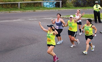 Runners showing enthusiam along the course.