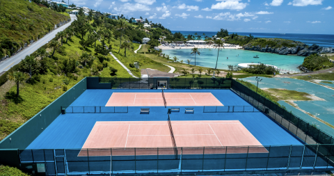 An aerial view of the pink oceanfront tennis courts at the Hamilton Princess