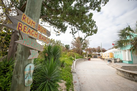 A hand-painted sign points the way to Horseshoe Bay Beach and Rum Bum Beach Bar