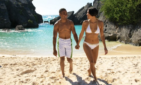 A couple walks on the Beach at Jobson's Cove in Bermuda