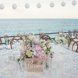 A wedding table setting in Bermuda with the Atlantic as a backdrop