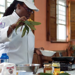 Bermudian chef preps a meal for a meeting event