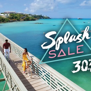 couple on bike across bridge over Bermuda water with Splash Sale 30% off logo