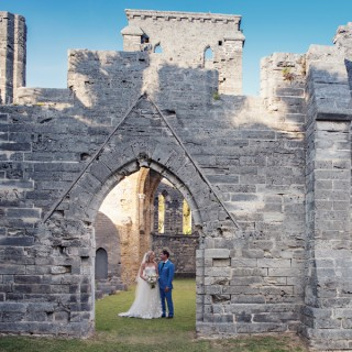 A newlywed couple enjoys a peaceful moment at the Unfinished Church