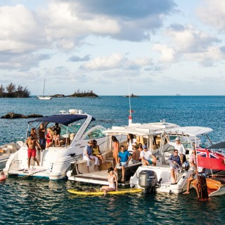 group of people having fun on boats in Bermuda