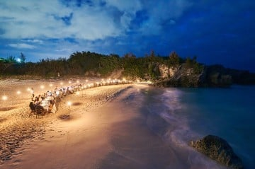Beachside dinner event with farm-to-table menu and panoramic views of Chaplin Bay