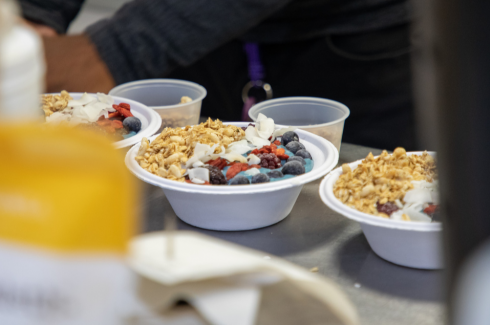 A breakfast bowl with granola and blueberries