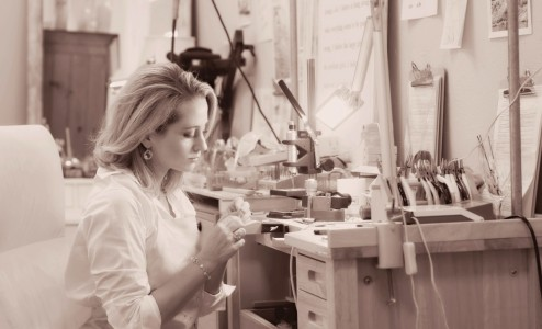 Alexandra at her Bench - Alexandra hand sculpts every design in her collection