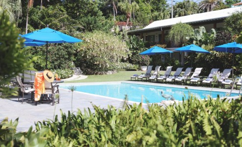 Back Garden Swimming Pool - Our outdoor swimming pool - heated year round - is surrounded by colorful and tropical flora and fauna. Enjoy your breakfast poolside, take an early morning dip or just bring a favourite book to read on one of the many...